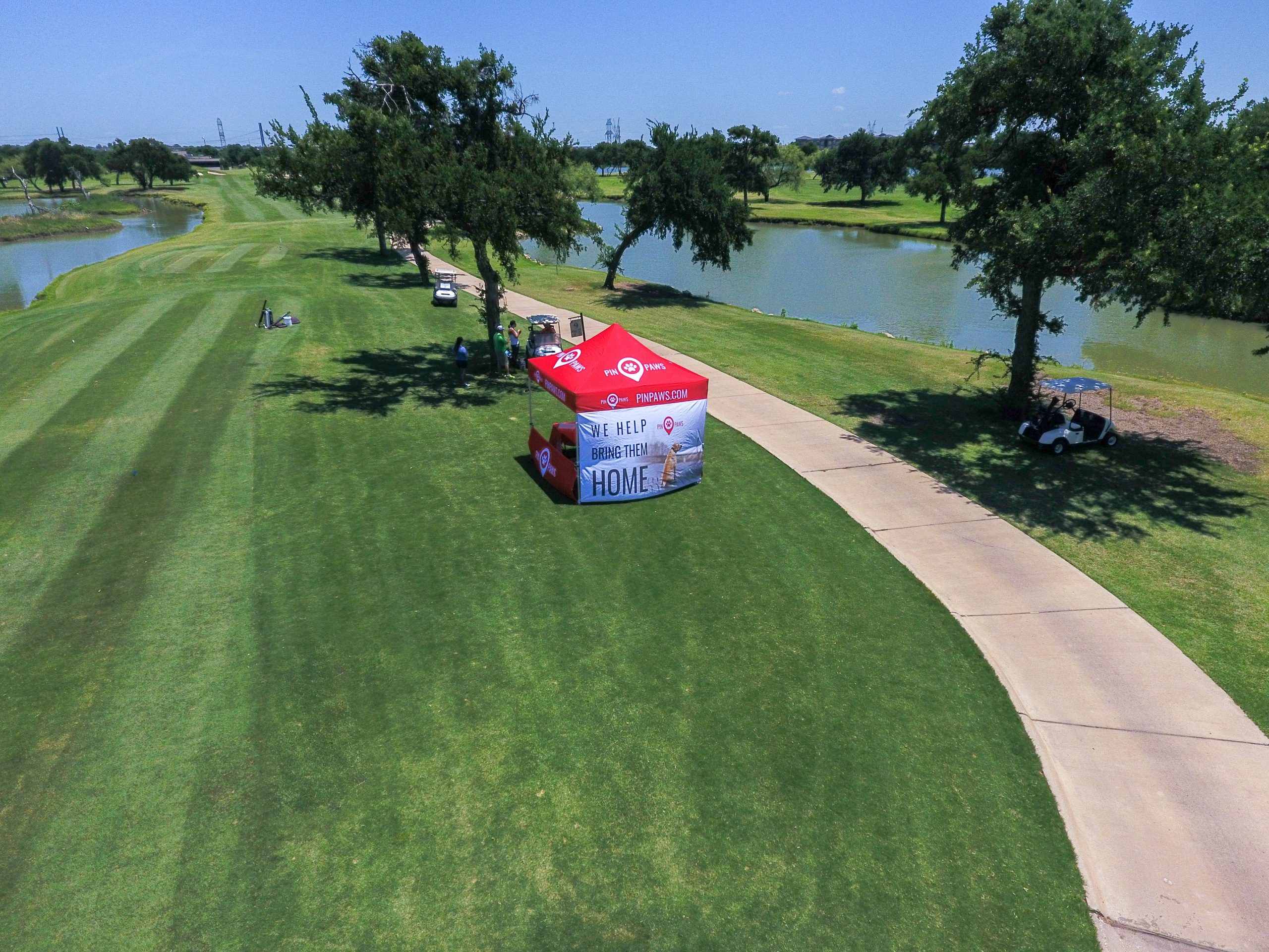 Drone photo over HRC tournament with Pin Paws booth hosting shot gun golf hole